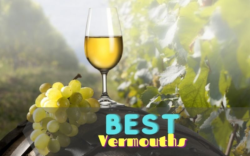 Vermouth in a wine glass with white grape on the side