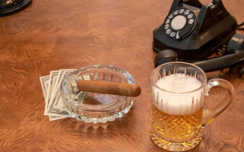 Cigar and beer in a vintage setting
