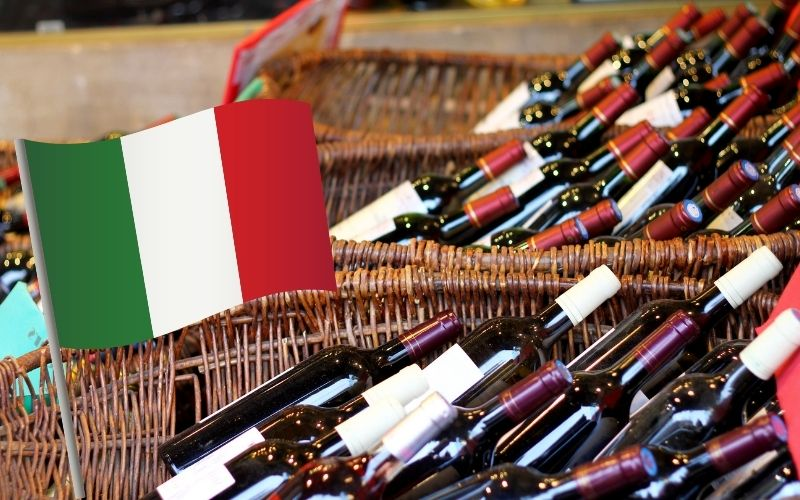 Wine bottles in baskets with Italy's Flag