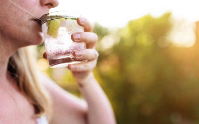 Woman drinking gin and tonic