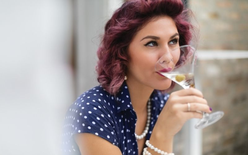 Woman sipping on a martini