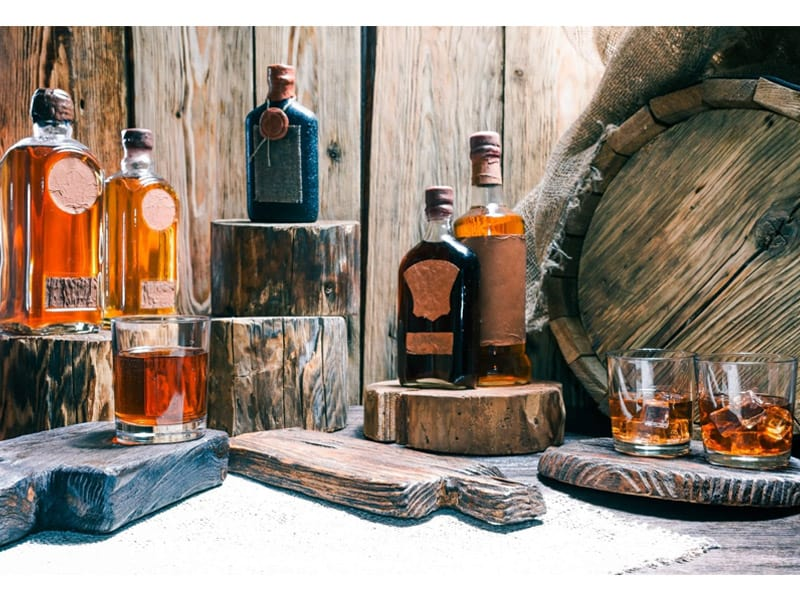 Whiskey bottles in rustic style