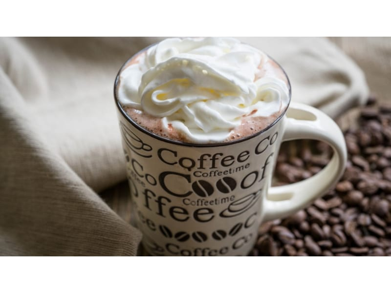 A cup of cowboy coffee with whip cream