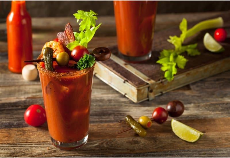 A glass of bloody mary with garnishes