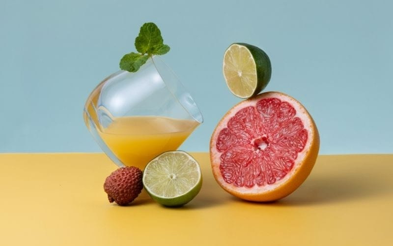 A glass of Grapefruit, Lime, and Lychee Fizz