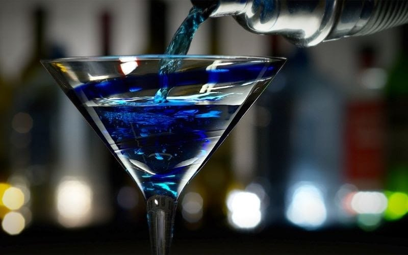 A glass of the blue train cocktail