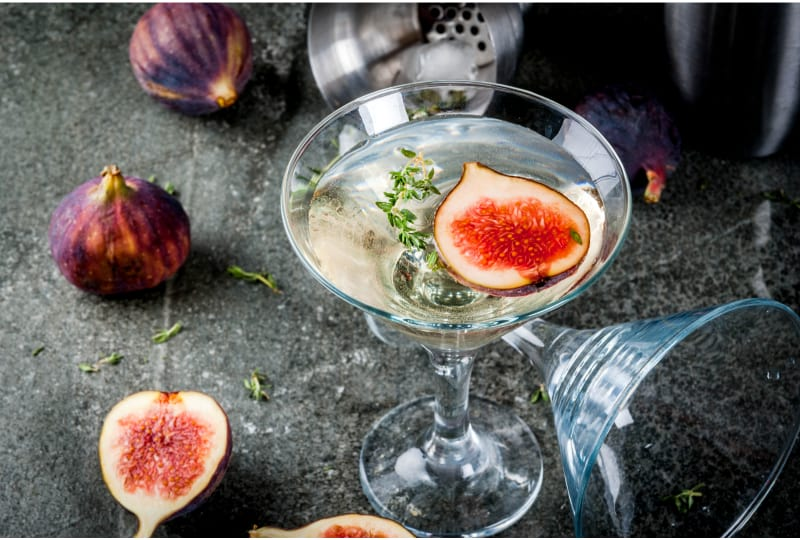 A glass of wine with figs