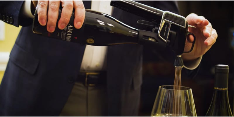 A man pouring a wine using Coravin wine Aerator