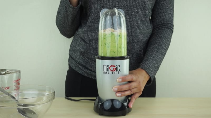 A person using a single-served blender