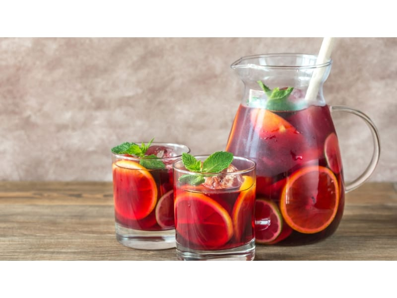 A pitcher and two glasses of sangria