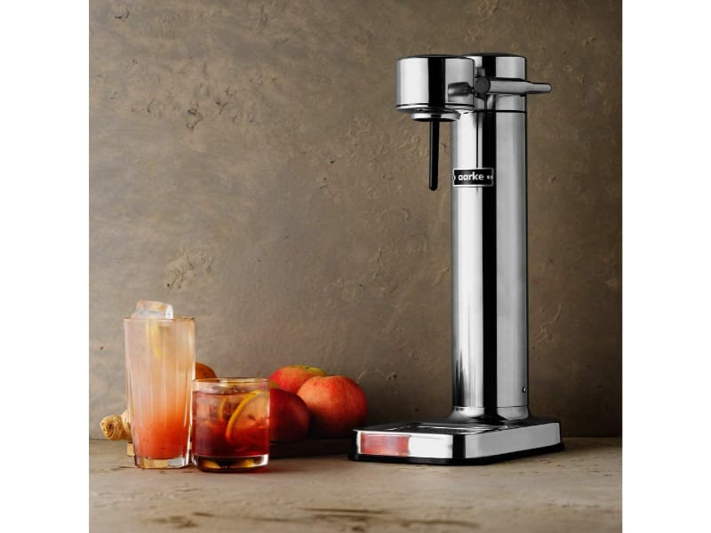Aarke soda maker with a red drink on the side