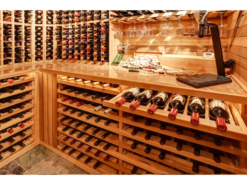 Wine bottle collection with wine glasses and corks