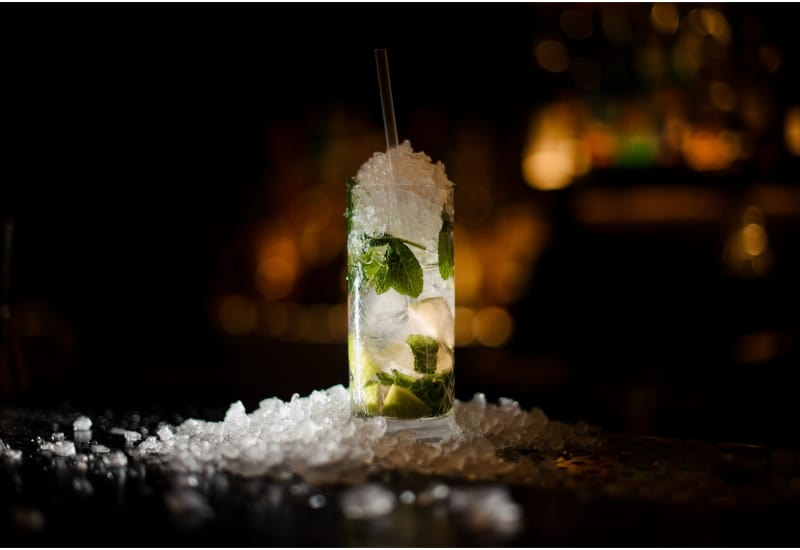 alcoholic cocktail mojito stands on a bar counter