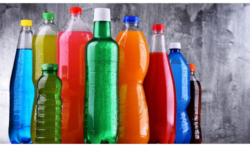 An assortment of colorful plastic soda bottles