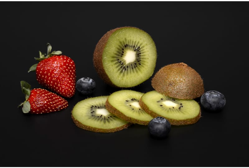 Assorted strawberries, kiwis, and blueberries