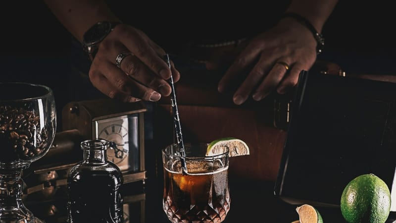 Black Magic cocktail being mixed with a bar spoon