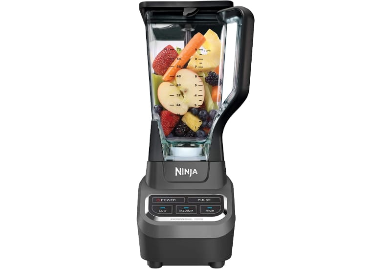 Blender with fruits and vegetables