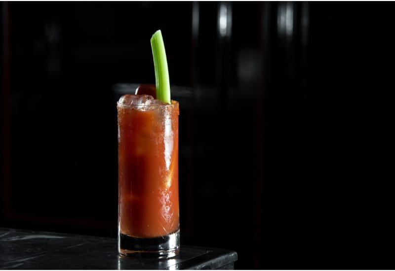 Bloody Mary on a bar desk in black background