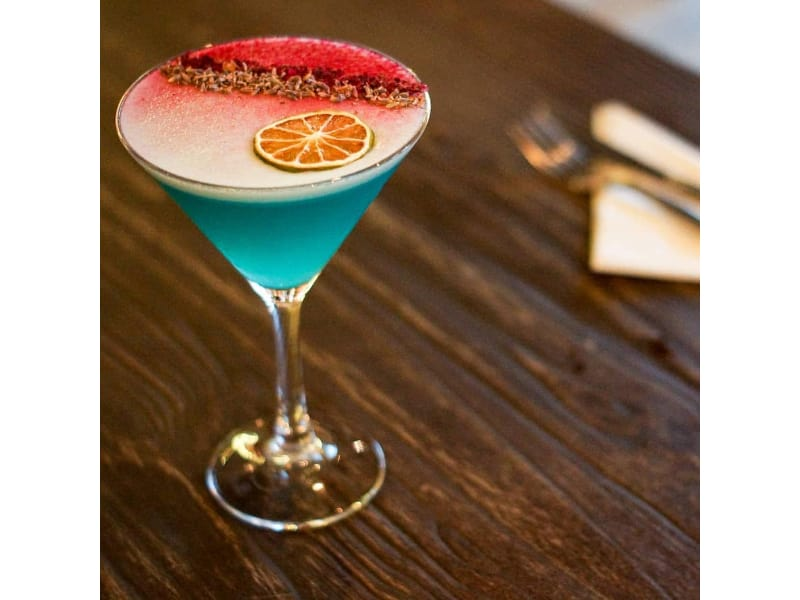 Blue Beauty cocktail in a martini glass