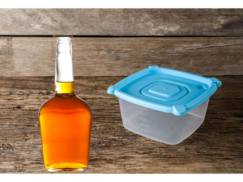 Bottle of bourbon and plastic container