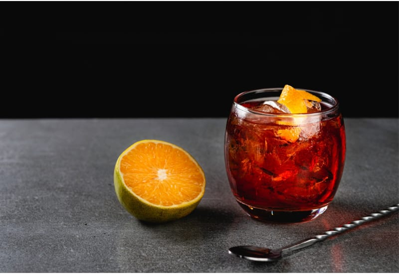 Boulevardier cocktail on stone background in gray color