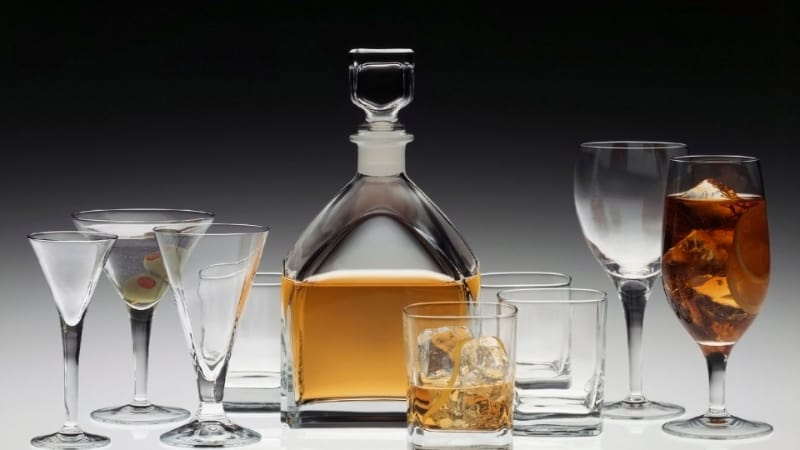 Bourbon in a decanter with various glasses