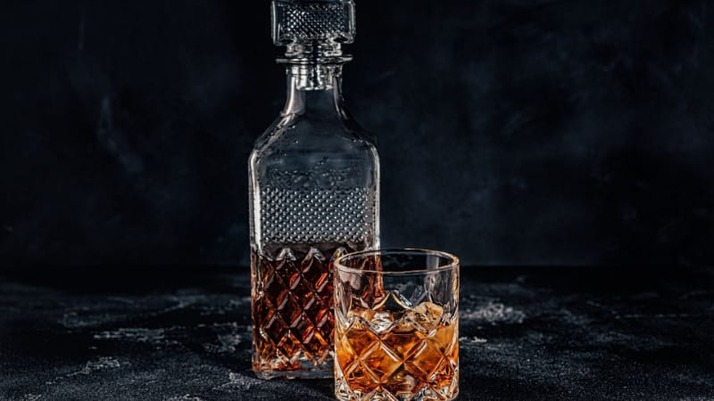 Bourbon whiskey in a decanter and a glass