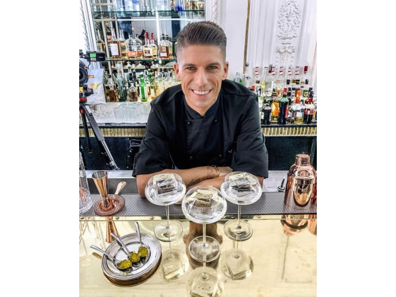 Bruno Vanzan with three glasses of cocktail and other bar tools