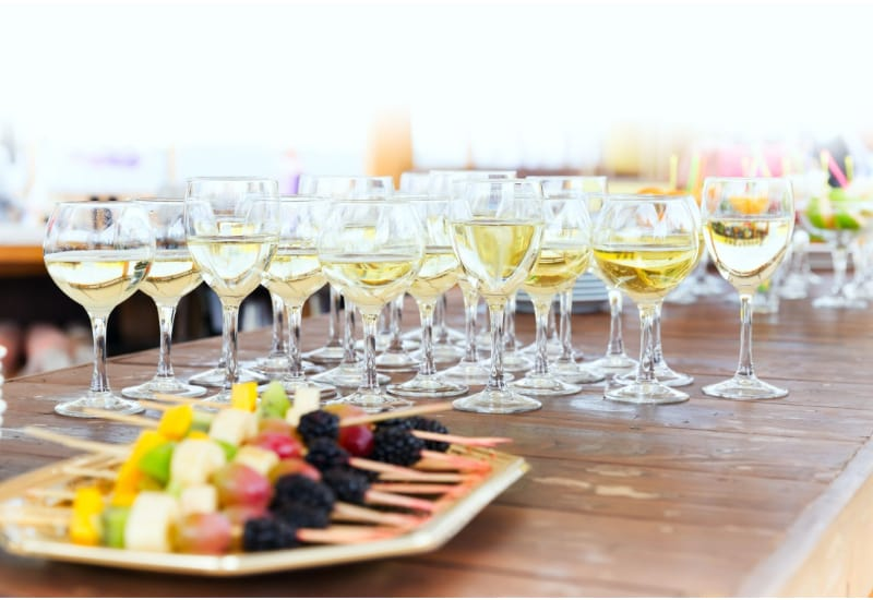 Champagne glasses and white wine on a wooden table