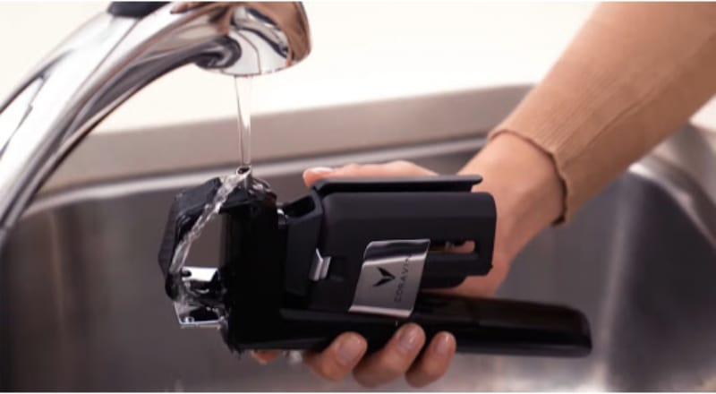 Washing the Coravin wine preservation system in the faucet