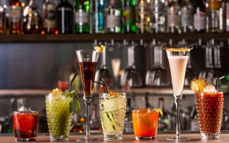 Cocktail glasses with garnishes on a bar counter