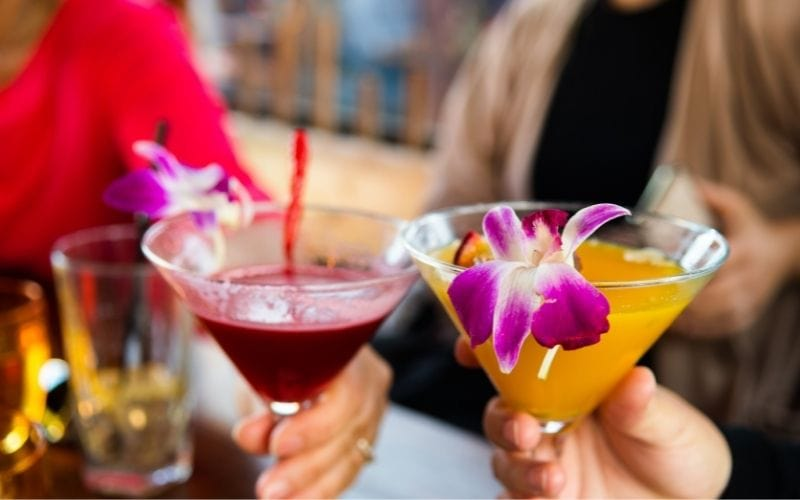 Cocktails in glasses with orchid flowers