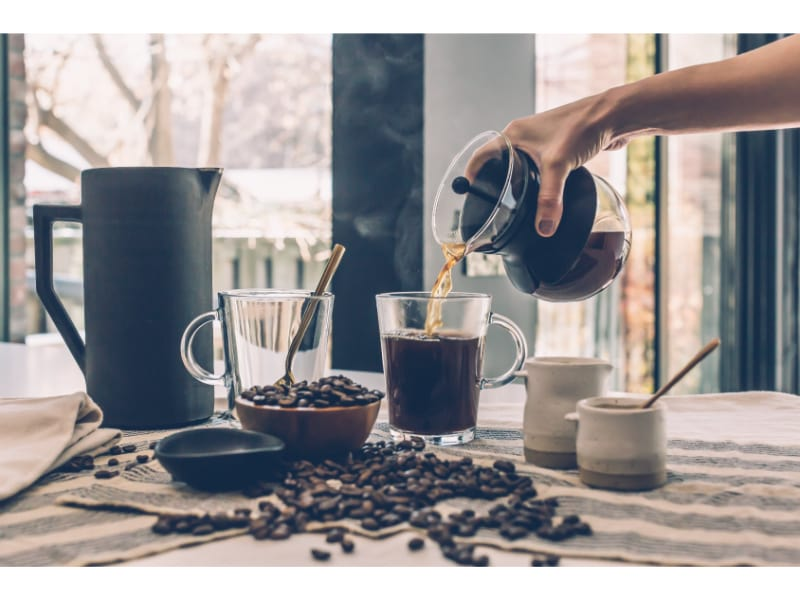 Brewed coffee being poured to a cup