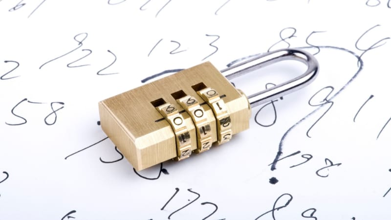 Combination lock with numbers written on a paper