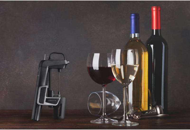 Coravin, 2 wine glasses and 2 bottle of wine on the table