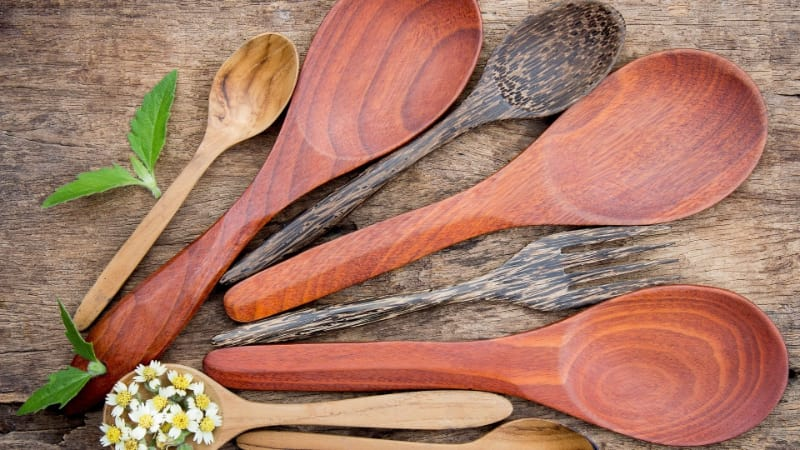 Different colors and sizes of a wooden spoon