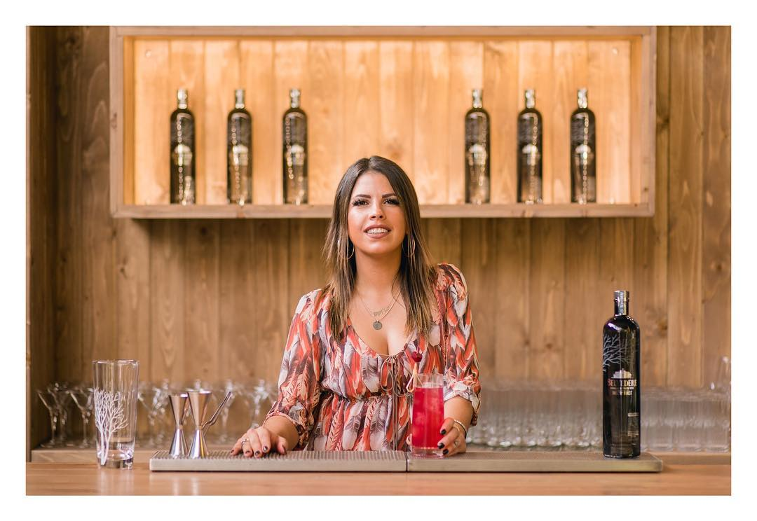 Dimitra Adonakopoulou holding a glass of cocktail