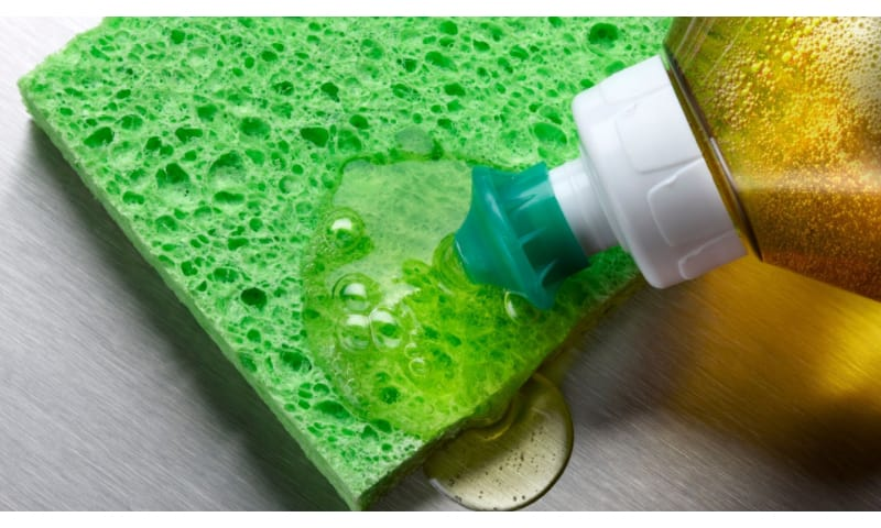 Dish soap on a green sponge