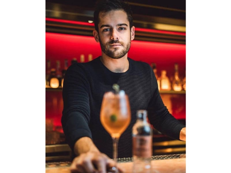 Federico Pasian holding a glass of cocktail