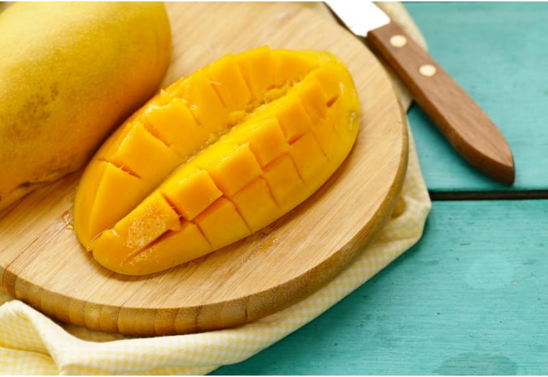Fresh Tropical Mango Fruit on a Wooden Background