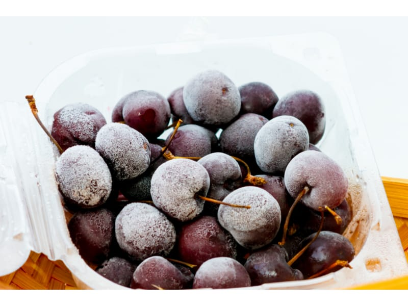 Frozen grapes in a plastic container