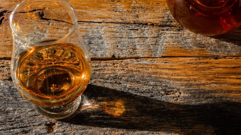 Glass of Irish whiskey on a wooden table