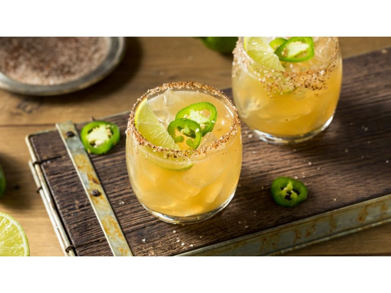 Glasses of Jalapeno Margarita with sliced chilies