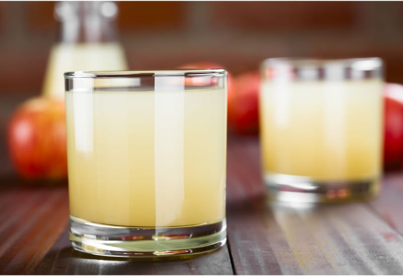 Glasses of Wild Sacramento drink with apples