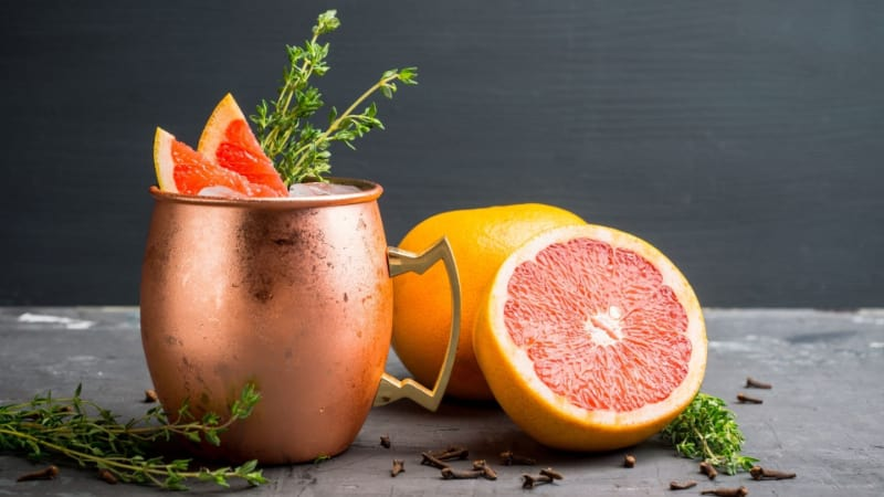 Greyhound cocktail with grapefruit, cinnamon, and star anise in a copper mug