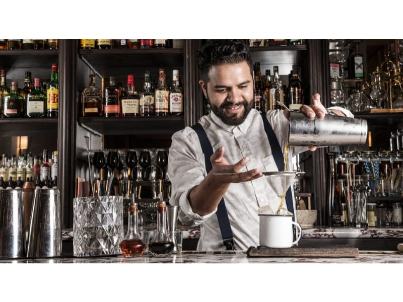 a bartender pouring drinks