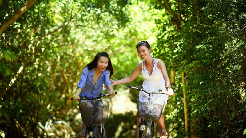 Happy and healthy women biking together