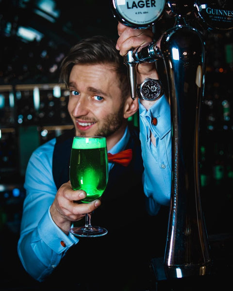 Ivan Skyba holding a glass of cocktail