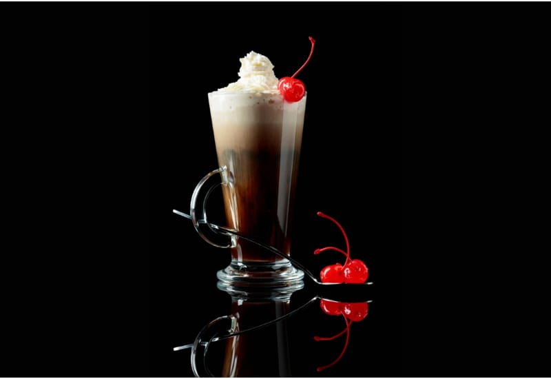 Layered coffee cocktail with whipped cream