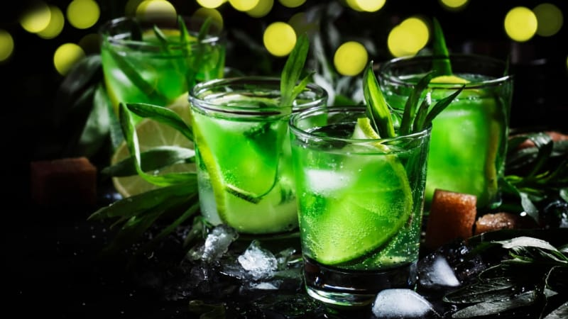 Liquid Marijuana Cocktail in shot glasses with lime